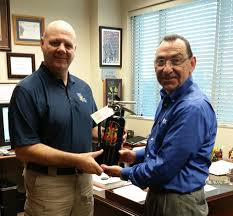 Danny Brown presenting fire ext to Butch Browning